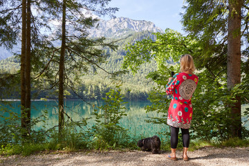 Woman taking a photo of lake Vorder Langbathsee