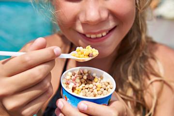 Girl eating ice cream small balls