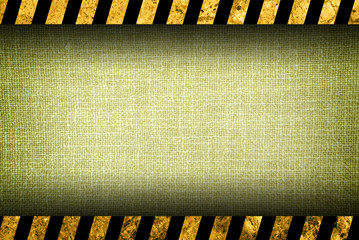 Grunge ivory textile background with black and yellow warning stripes