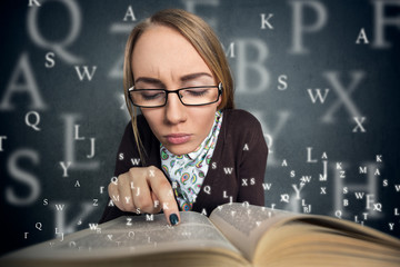 girl reading a book with letters coming out of the book