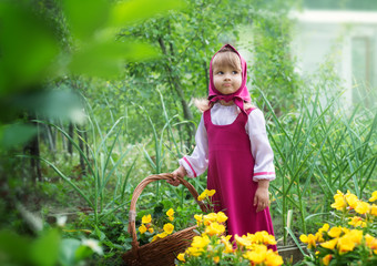 Small village girl in folk costume with a basket