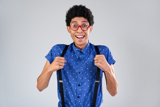 Funny guy portrait with suspenders and glasses surprised emotion