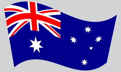 Flag of Australia waving on gray background