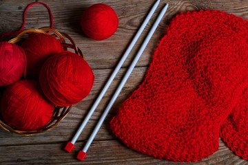 handcraft red knitted fabric on a wooden background