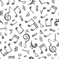Hand drawn music notes seamless pattern. Vector musical background in black and white colors.