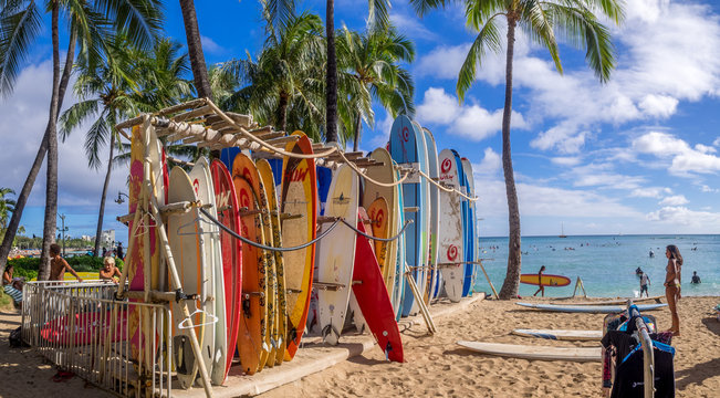 Surfboards lined up on Waikiki beach.