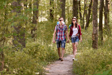 Young Boy and Girl enjoying Walk in Summer Forest