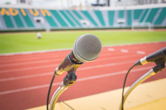 Microphone on table side sport field in stadium for commentator.