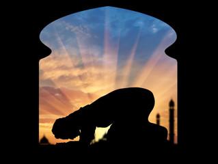 Muslim praying in a room