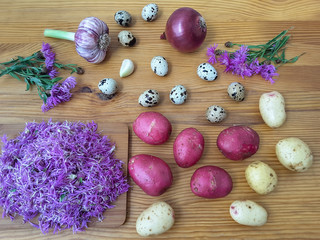 Cooking knapweed potatoes burgers with quail eggs, garlic and onion