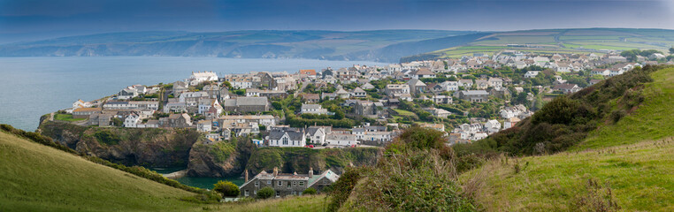 Panoramic view of Port Isaac in northern Cornwall. View from the coast path approaching from the west of the village.