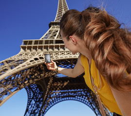 young woman taking photo with camera while in Paris, France
