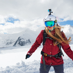 Snowboarder girl in   red jacket
