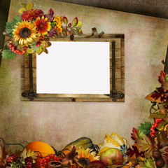 Autumn background with frame, flowers, leaves, berries and pumpkins