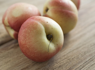 Peaches lie on the old Board. Close-up