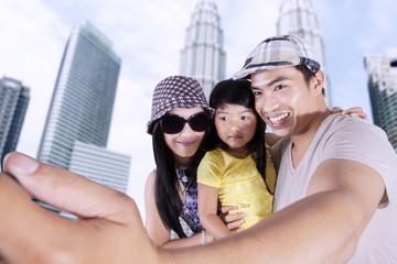 Asian family taking selfie photo