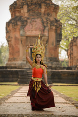 A beautiful woman in dancer apsara costume at stone castle,publi