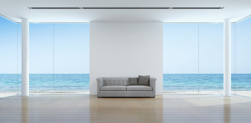 Wall Mural - Sea view living room interior in modern beach house - 3D rendering