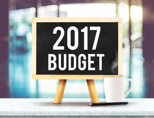 2017 budget on blackboard with easel on black marble table with