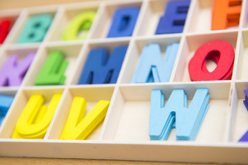 Colorful wooden english letters in box