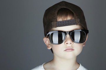 little boy. fashion children.handsome in sunglasses and Cap