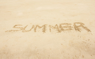 Summer Handwritten On Sand Summer Background Concept