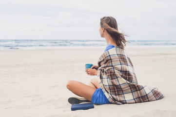 Young woman looking at the sea. Relaxation concept