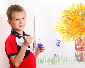 boy draws a picture