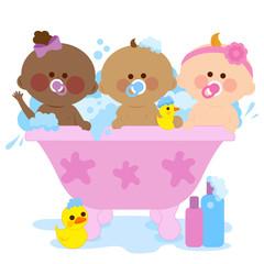 Babies in a tub taking a bath