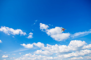 Flying a kite up high. Space the text