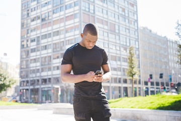 Young man, outdoors, using smartphone