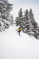 Man snowboarding in mountains