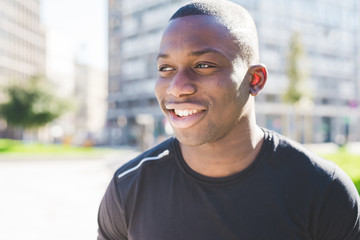 Portrait of young man outdoors, smiling