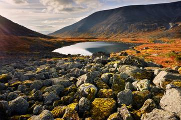 Rocks and autumn colours in Malaya Belaya River valley, Khibiny mountains, Kola Peninsula, Russia
