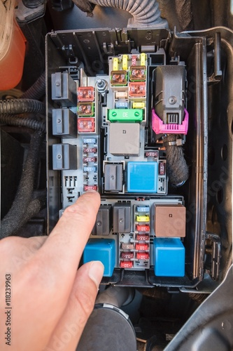 hand checking a fuse in the fuse box of a modern car engine stock rh fotolia com modern domestic fuse box modern house fuse box
