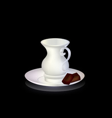white cup and chocolate