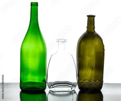 Colored empty glass bottles for wine isolated on white for Where to buy colored wine bottles