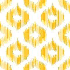 Ikat fabric pattern, abstract geometric pattern. . Seamless vector background.  Vector illustration. Oriental rug pattern, in yellow, orange and red.