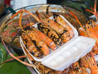 Grilled prawns on street market