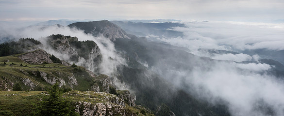 Foggy Landscape in mountains. A view from mountains to the valley covered with foggy landscape.