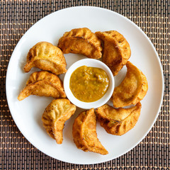 Plate of fried Nepalese moms and its achar (sauce)