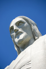 Close-up portrait of the face of Christ the Redeemer at Corcovado in blue sky in Rio de Janeiro Brazil