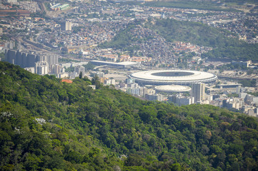 Rio de Janeiro, Brazil city skyline view from above featuring misty crowded cityscape beyond jungle greenery