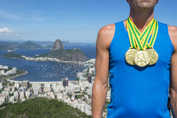 Gold medal champion athlete standing at a scenic skyline overlook of Rio de Janeiro, Brazil