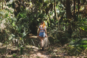 Woman exploring forest, Bonita Springs, Florida