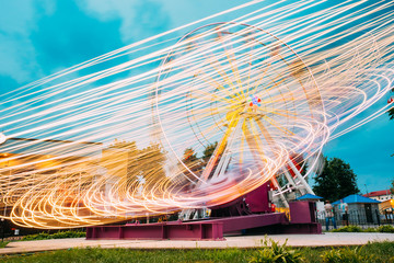 Motion Blurred Of High Speed Rotating Attraction Amusement Park.