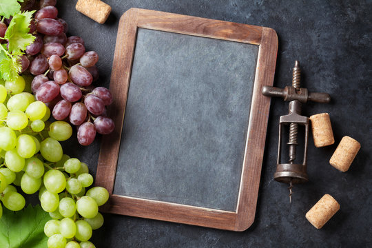 Red and white grapes and chalkboard