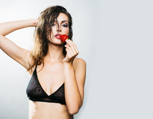 sexy pretty woman with red strawberry
