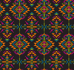 Colorful ethnic seamless pattern with geometric shapes.