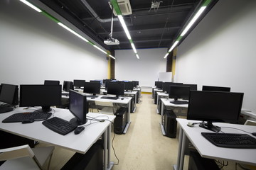 Classroom with modern computers in British high school of design.